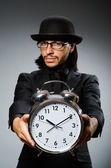 Man with clock wearing vintage hat — Stock Photo