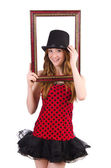 Pretty girl in red polka dot   dress with picture frame  isolate — Stock Photo