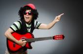 Man with funny haircut and guitar — Stock Photo