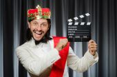 King with movie board in funny concept — Stock fotografie