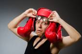 Funny boxer with red gloves against dark background — Stockfoto