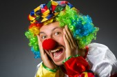 Funny clown in colourful costume — Stock Photo