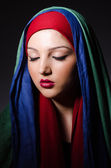 Portrait of the young woman with headscarf — Stock Photo