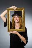 Woman with vintage hat and picture frame — Stock fotografie