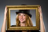 Woman with vintage hat and picture frame — Stockfoto