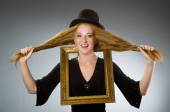 Woman with vintage hat and picture frame — Foto Stock