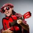 Funny scotsman playing red guitar — Stockfoto #54431271