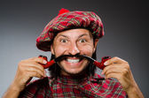 Funny scotsman with smoking pipe — Foto de Stock