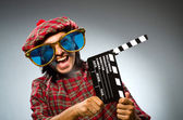 Funny scotsman with movie clapboard — Foto Stock