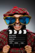 Funny scotsman with movie clapboard — Stock fotografie