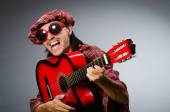 Funny scotsman playing red guitar — Foto Stock