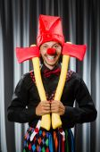 Funny clown with red axe — Stock Photo