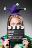 Film clapper kurulu ile palyaço — Stok fotoğraf