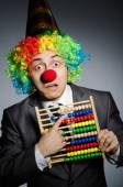 Funny clown businessman with abacus — Stok fotoğraf