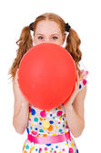 Young woman with red balloon isolated on white — Stock Photo