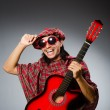 Funny scotsman playing red guitar — Foto de Stock   #55857939