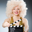 Blond woman with movie board — Stock Photo #55860371