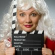 Blond woman with movie board — Stock Photo #55862993
