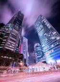 Skysrapers in Singapore during night hours — Stock Photo
