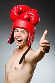 Funny boxer against dark background — Stock Photo