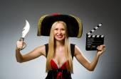 Woman pirate against grey background — Stock Photo
