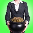 Woman holding pot of gold coins — Stock Photo #57235217