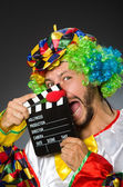 Clown with movie clapper board — Stock Photo