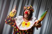 Funny clown with colourful umbrella — Stock Photo