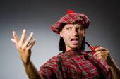 Funny scotsman with smoking pipe — Stock Photo