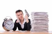 Woman with gun under stress from deadlines — Stock Photo