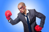 Badly beaten businessman with boxing gloves — Stock Photo