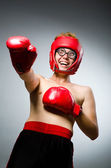 Funny boxer against dark background — Stock Photo