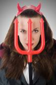 Female wearing devil costume and trident — Stock Photo
