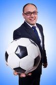 Businessman with football on white — Stock Photo