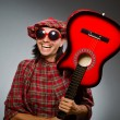 Funny scotsman playing red guitar — Foto de Stock   #57364765