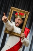 King with picture frame in funny concept — Stock Photo