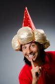 Funny wizard wearing red dress — Stock Photo
