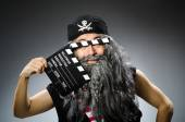 Old pirate with movie board — Stock Photo