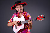 Man wearing sombrero with guitar — Stock Photo
