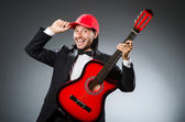 Funny guitar player in studio — Stock Photo