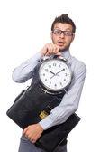 Man with clock trying to meet the deadline — Zdjęcie stockowe
