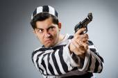 Funny prison inmate with gun — Stock Photo