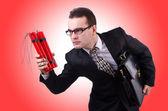 Businessman with dynamite — Stock Photo