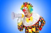 Clown with loudspeaker on white — Stock Photo