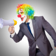 Businessman clown with loudspeaker on white — Stock Photo #57944067