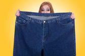 Dieting concept with oversize jeans — Stock Photo