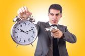 Man with gun and clock — Zdjęcie stockowe