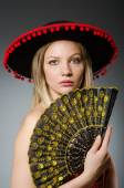 Woman dancing with fans — Stock Photo
