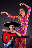 Spanish pair playing guitar and dancing — Foto de Stock