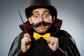 Funny magician man with wand and hat — Stock Photo